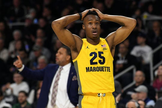Marquette guard Koby McEwen reacts to a call in the second half during the Golden Eagles' loss to Providence.
