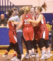 The Flippin Lady Bobcats celebrate after winning the district championship Friday night.