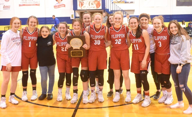 The Flippin Lady Bobcats won the 2A-1 District Tournament championship on Friday night at Decatur.