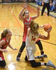 Norfork's Kylie Manes and Aeja McFall battle Viola's Lindsey Browning for a loose ball earlier in the season. The two teams will meet Saturday night for the 1A-2 District title.