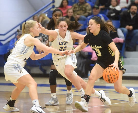 Mountain Home's Leah Jackson and Kate Gilbert defend Nettleton's Briley Pena during their meeting earlier this season. The Lady Bombers defeated Nettleton on the road Friday.
