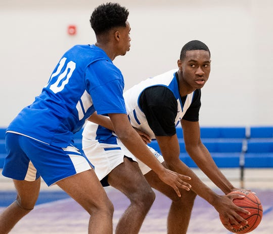Catholic's Jalen Thomas (10) and Justin Bufford (1) at Catholic High School in Montgomery, Ala., on Saturday February 22, 2020.