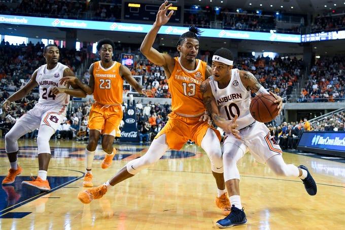 Auburn guard Samir Doughty (10) drives past Tennessee guard Jalen Johnson (13) during the second half of an NCAA college basketball game Saturday, Feb. 22, 2020, in Auburn, Ala. (AP Photo/Julie Bennett)
