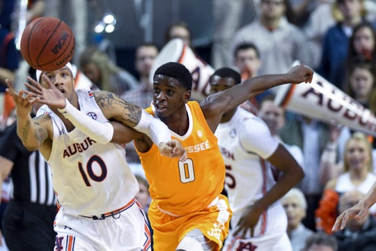 Auburn guard Samir Doughty (10) and Tennessee guard Davonte Gaines (0) chase down a loose ball on Saturday, Feb. 22, 2020, in Auburn, Ala.