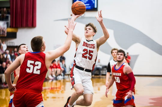 Blackford's Luke Brown shoots past Southern Wells' defense during their game at Blackford High School Friday, Feb. 21, 2020.