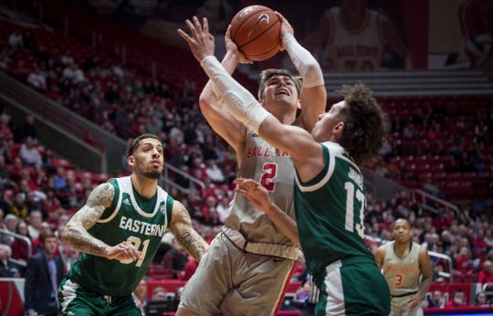 Ball State's Luke Bumbalough tries to get past Eastern Michigan University's defense on Feb. 22 during a home game at Worthen Arena. Ball State overtook Eastern Michigan 64-55.