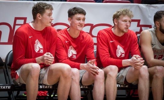Ball State basketball players Blake Huggins (left), Lucas Kroft (center) and Ben Hendriks (right) look on as Ball State beats Eastern Michigan 64-55 on Feb. 22 inside Worthen Arena.