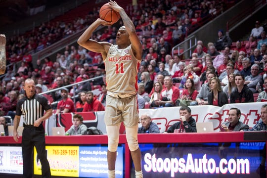 Ball State's Jarron Coleman shoots a three point shot on Feb. 22 during a home game at Worthen Arena. Ball State overtook Eastern Michigan 64-55.
