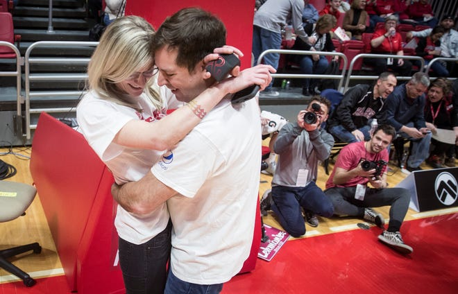 Jeff Van Zandt and Chrissy Bennett embrace after getting engaged during the Ball State University basketball game on Feb. 22 inside Worthen Arena.
