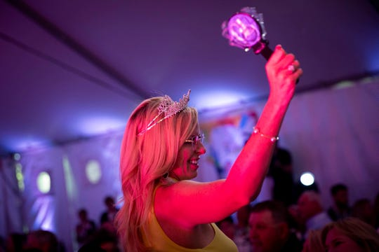 Brooke Denson cheers during the 12th annual Southwest Florida Wine & Food Fest at the Hyatt Regency Coconut Point Resort & Spa in Bonita Springs on Saturday, February 22, 2020.