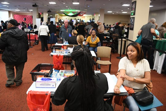 Holy Name Medical Center hosts a day of complimentary health screenings and seminars on Saturday, February 22, 2020. (Right) Kecia Powell, of Hackensack, has blood work done.