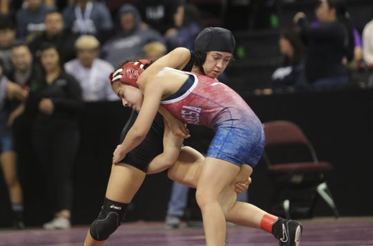 Oñate's Angelita Altamirano locks up West Mesa's Arianna Morales in the Girls 100-pound division semifinals during Saturday's New Mexico State Wrestling Championships at the Santa Ana Star Center in Rio Rancho.
