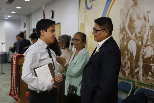 Kirtland Central High School graduate Randall R. Marshall, left, talks to Navajo Nation Council Delegate Nathaniel Brown after receiving the Chief Manuelito Scholarship on July 21, 2017 in Farmington.