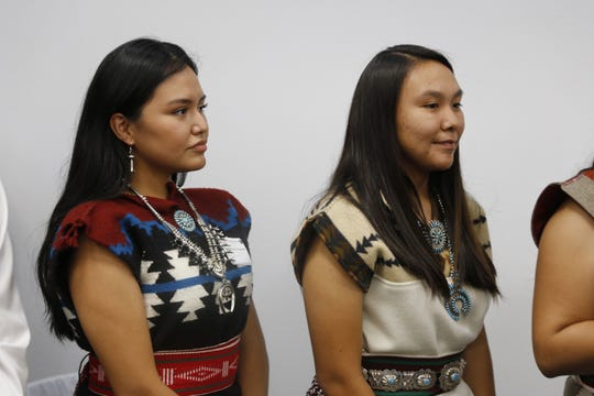 From left, Nazhoona Betsuie and Britany Begaye wait to be recognized for receiving the Chief Manuelito Scholarship during the July 21, 2017 awards ceremony at the Henderson Fine Arts Center at San Juan College in Farmington.