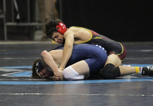 Centennial's Tye Barker grabs hold of Piedra Vista's Tyler Ramsted in the 5A 120-pound division semifinals during Saturday's New Mexico State Wrestling Championships at the Santa Ana Star Center in Rio Rancho.