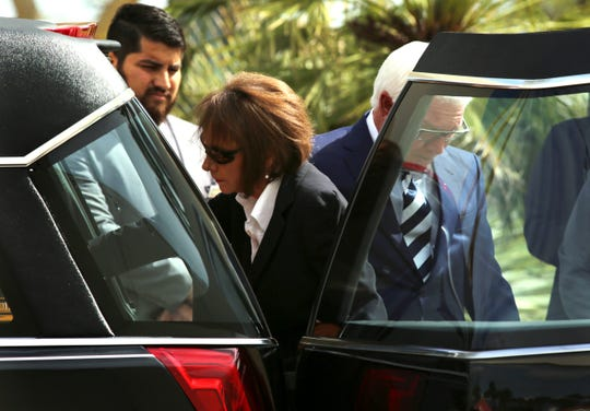 Jana Duffner touches her husbands' casket following the public funeral service for Dr. David Duffner at Southwest Church in Indian Wells, Calif., on February 22, 2020.