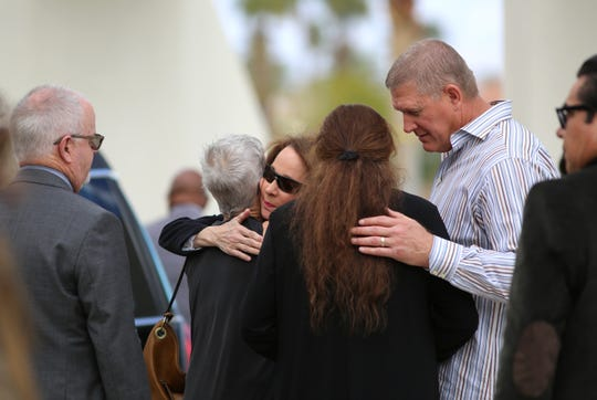 Jana Duffner, center, receives hugs following the public funeral service for her husband, Dr. David Duffner, at Southwest Church in Indian Wells, Calif., on February 22, 2020.