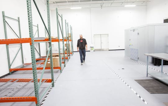 West Coast Cannabis Club's Ken Churchill opened a multi-use dispensary facility in Palm Desert in February 2020. In this photo, Churchill is seen in a production and storing area of the building.