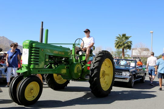 A 1948 John Deere Tractor heads to the auction block at the McCormick's Classic Car Auction in Palm Springs, Calif., on Friday, February 21, 2020.