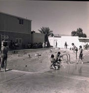 In 1962, children enjoy the newly-built  Pathfinder Pool at the Palm Springs Boys' Club.