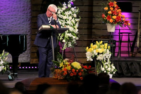 Dr. Peter Jamieson wipes his eyes during the public funeral service for Dr. David Duffner at Southwest Church in Indian Wells, Calif., on February 22, 2020.