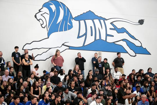 Cathedral City fans react during the CIF-SS Division 5A semifinal game against Banning in Cathedral City, Calif., on February 21, 2020.