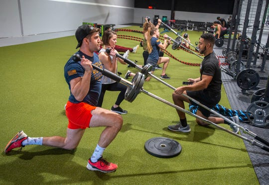 Trainer Giorgio Trane,right,  supervises during Fitness Impact Training at the GT Fitness Bootcamp Saturday, February 22, 2020.