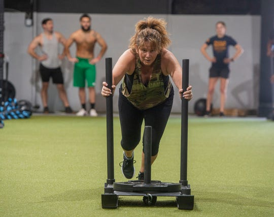 Participants work out during Fitness Impact Training at the GT Fitness Bootcamp Saturday, February 22, 2020.