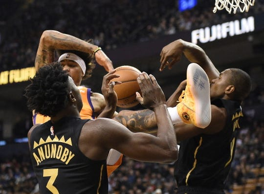Phoenix Suns forward Kelly Oubre Jr., back left, has his shot rejected by Toronto Raptors center Serge Ibaka, right, as Raptors forward OG Anunoby (3) watches during the first half of an NBA basketball game Friday, Feb. 21, 2020, in Toronto. (Frank Gunn/The Canadian Press via AP)