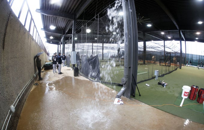 Arizona Diamondbacks take batting practice as rain pours off the roof Saturday morning as rain forces the cancellation of Cactus League opener between the Arizona Diamondbacks vs. the Colorado Rockies on Feb. 22, 2020 at Salt River Fields at Talking Stick in Scottsdale, Ariz.
