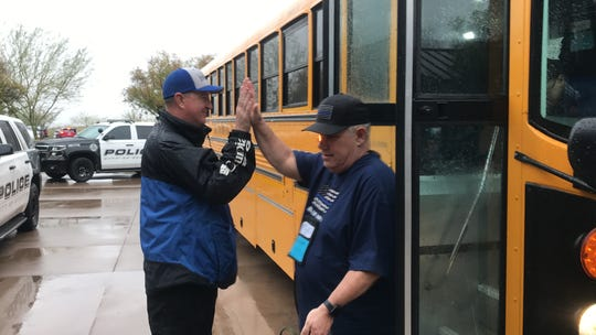 Volunteers greeted walkers as they walked off of a bus that brought them to the start of the COPS Southwest Walk 2020 on Saturday, Feb. 22, 2020.