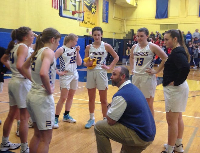 The Northern Lebanon girls basketball team listens to head coach Ken Battistelli during a timeout of its district playoff win vs. Bishop McDevitt Friday night.