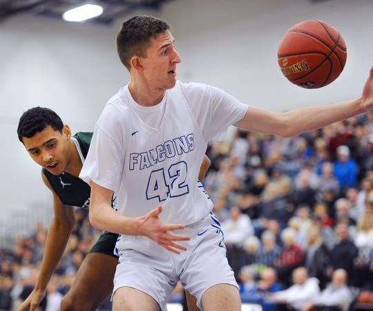 Cedar Crest's Jason Eberhart (42) gets control of a loose ball in front of Central Dauphin's Donovan Hill (30) during the first quarter of action.