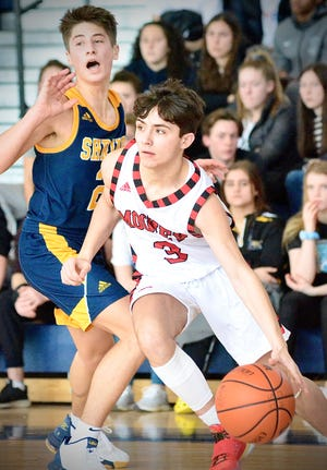 Cardinal Mooney's Luc Julio drives to the hoop against Royal Oak Shrine in the opening round of the Catholic League boys basketball tournament on Saturday, Feb. 22, 2020, at Academy of the Sacred Heart in Bloomfield Hills.