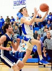 Croswell-Lexington's Saige Slanec attempts a layup against Algonac during a Blue Water Area Conference boys basketball game on Friday, Feb. 21, 2020.