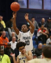 Poughkeepsie's Ali Harrell takes a jump shot over Beacon's Kamron Torres during Friday's playoff game on February 21, 2020.