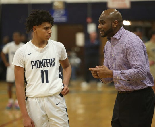 Poughkeepsie boys basketball coach Cody Moffett gives instruction to Javel Cherry during their Feb. 21 game against Beacon.