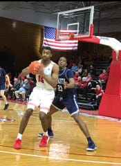 Jordan Jones looks for an open man during Friday's game.