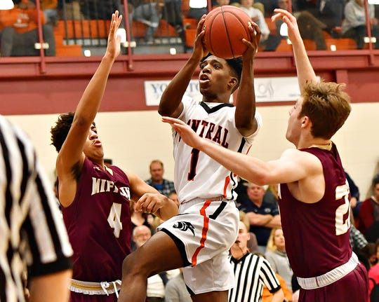 Central York's Taylor Wright-Rawls, center, takes the ball to the basket while Governor Mifflin's CamRon Stewart, left, and Joshua Klahr defend during PIAA District III, Class 6-A boys' basketball quarterfinal action at Central York High School in Springettsbury Township, Friday, Feb. 21, 2020. Central York would win the game 56-46. Dawn J. Sagert photo