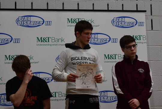 Biglerville sophomore Levi Haines prepares to accept his gold medal after winning the 126-pound District 3 Class 2A title at Central Dauphin East on Saturday.