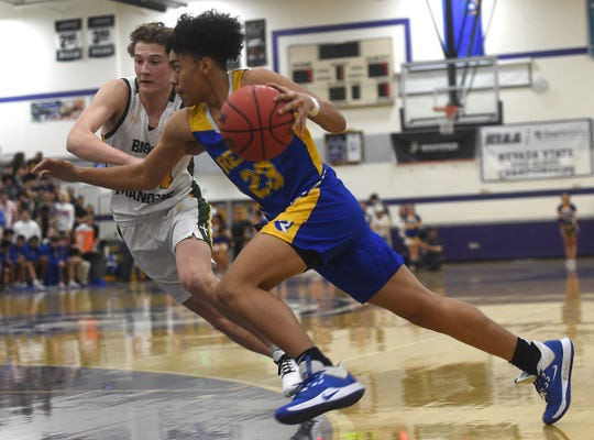 Reed's Michael Agee drives while taking on Bishop Manogue during the NIAA Northern Region boys basketball semifinals at Spanish Springs on Feb. 21, 2020.