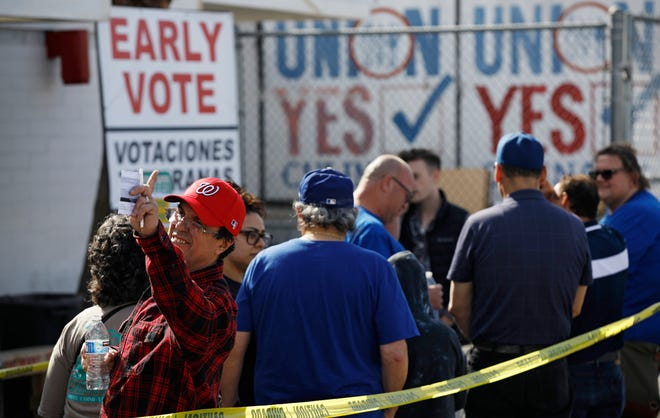 People wait in line to vote early at the Culinary Workers union Monday, Feb. 17, 2020, in Las Vegas. Nevada's first-in-the West presidential caucus puts the spotlight Saturday on a state that has swung increasingly blue over the last two decades.