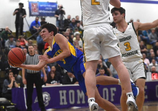 Reed's Trey Stevens shoots while taking on Bishop Manogue during the NIAA Northern Region boys basketball semi-finals at Spanish Springs in Reno on Feb. 21, 2020.