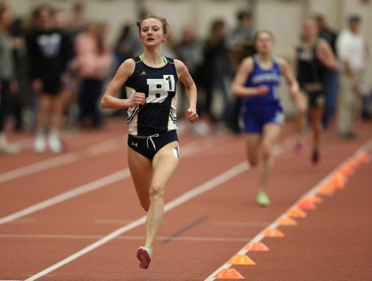 Brighton's Eilee Ossont has a comfortable lead to win the 1500 meter run.