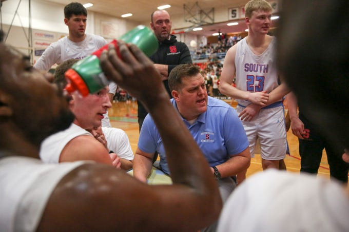 South's head coach Travis Brown strategizes with his players during their boys basketball game against West at South Salem High School on Feb. 21, 2020. South edged out West, 66-49.
