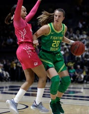 Oregon's Sabrina Ionescu, right, drives the ball against California's Cailyn Crocker in the first half of an NCAA college basketball game Feb. 21, 2020, in Berkeley, Calif.