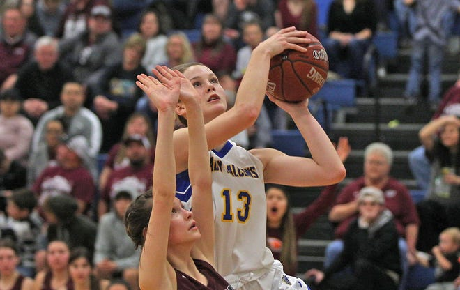 Bella Halfmann drives to the basket for Veribest during a playoff game against Rankin on Friday, Feb. 21, 2020.