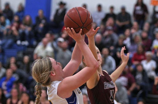 Kennadi Wheeless, left, drives toward the basket for Veribest during a game against Rankin on Friday, Feb. 21, 2020.