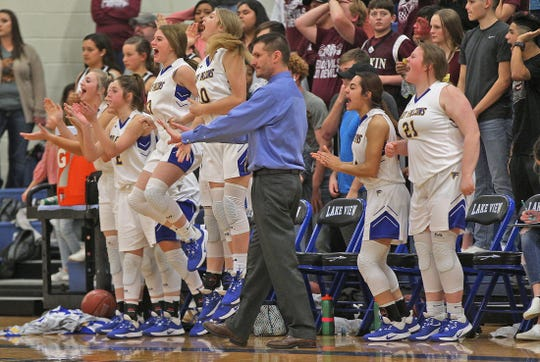 Members of the Veribest girls basketball team celebrate a score as head coach Chris Schlicke, center, gives direction to his team during a game against Rankin on Friday, Feb. 21, 2020.