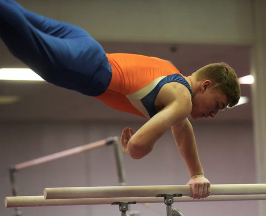 San Angelo Central High School's Ian Hamby competes on parallel bars during a home gymnastics meet against Saginaw on Saturday, Feb. 22, 2020.